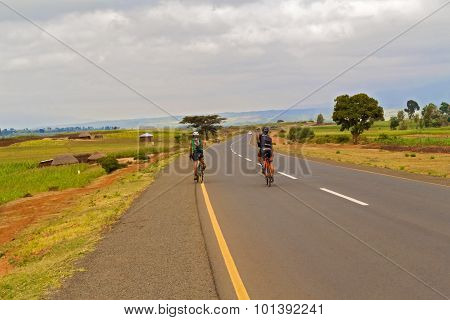 Two Men Riding Bicycle In Tanzania