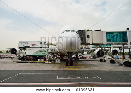 DUBAI, UAE - JUNE 23, 2015: A380 docked in Dubai airport. Dubai International Airport is an international airport serving Dubai.