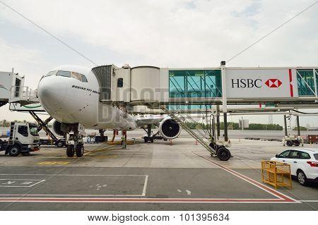 DUBAI, UAE - JUNE 23, 2015: Boeing 777-300ER docked in Dubai airport. Dubai International Airport is an international airport serving Dubai.