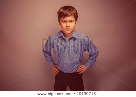 portrait of a teenage boy frowning brown hair of European appear