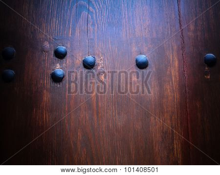 Abstract wooden background with metallic decorations