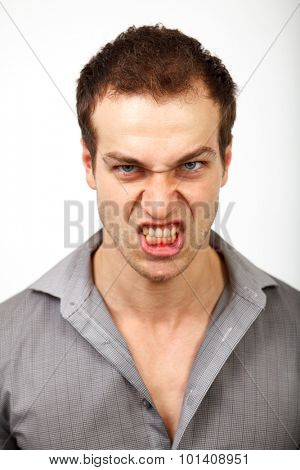 Angry upset man with scary evil face