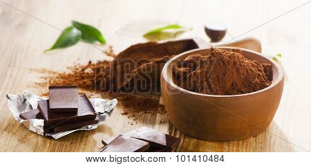 Chocolate Bars And Bowl Of Cacao Powder.