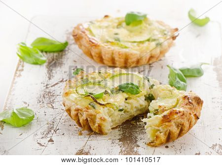 Tart With Cheese On A Wooden Background.