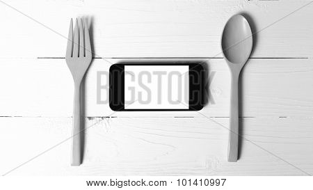 Spoon And Smart Phone Concept Eating Social Black And White Tone Color Style