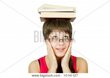 Girl In Glasses With Books On Head