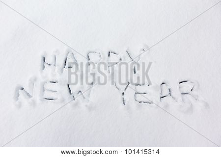 Happy new year text on snow