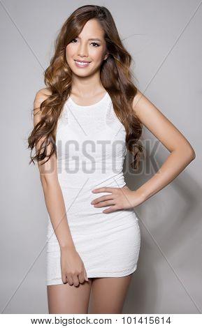 beautiful asian young woman in white dress with flawless skin