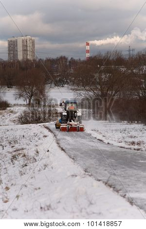 Tractor Driving Down A Snow Covered Road