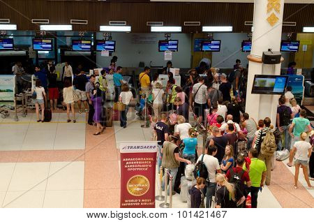 Phuket - Oct 19: Passengers Arrive At Check-in Counters At Phuket Airport On Oct 19, 2013 In Phuket,