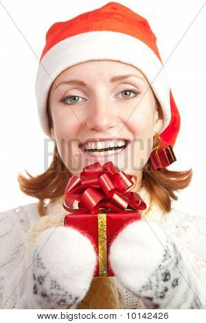 Happy Smiling Woman In Christmas Hat And Mittens With Gift