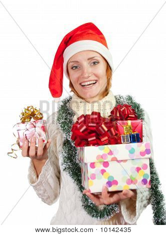 Happy Smiling Woman In Christmas Hat With Gifts