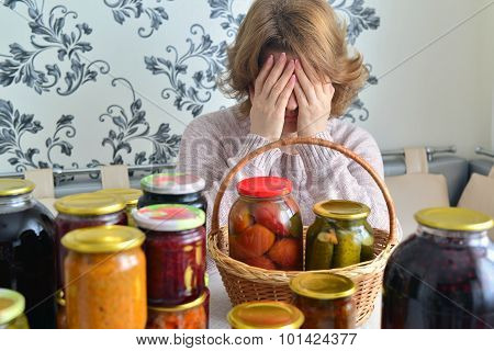 Tired Woman Sitting Near Home Canning For  Winter