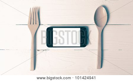 Spoon And Smart Phone Concept Eating Social Vintage Style