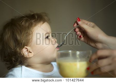 Nice Child Boy Eating Soup