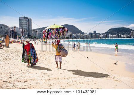 RIO DE JANEIRO, BRAZIL - APRIL 24, 2015: Brazilian street vendors sells swimsuit and scarf on April 24, 2015 at Copacabana Beach, Rio de Janeiro. Brazil.