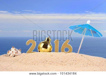 2016 Year Golden Figures On A Beach Sand