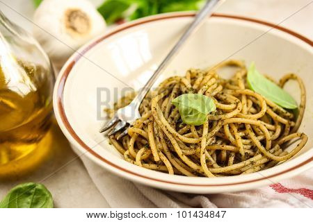 Pesto pasta in a white bowl