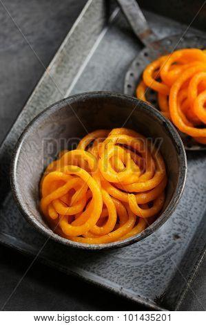 Jilebi Selective focus - Indian Sweet on a rustic background