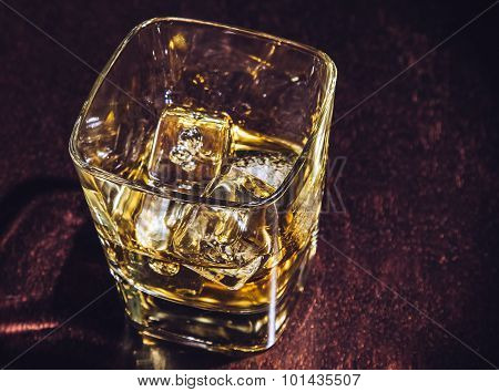 Top Of View Of Glass Of Whiskey On Wood Table, Warm Atmosphere