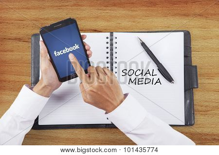 Entrepreneur Hand Touch The Logo Of Facebook Site