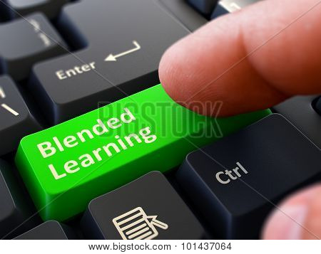 Press Button Blended Learning on Black Keyboard.