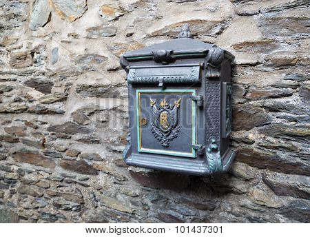 Old Postbox On Stone Wall.
