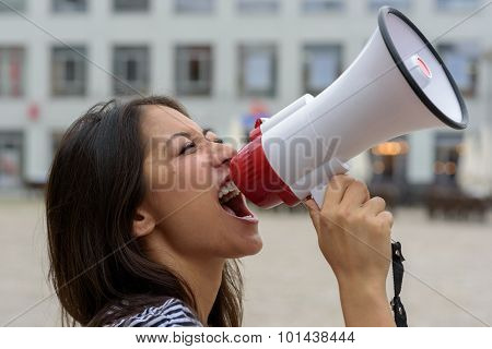 Woman Yelling Into A Bullhorn On An Urban Street