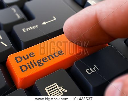 Due Diligence - Written on Orange Keyboard Key.
