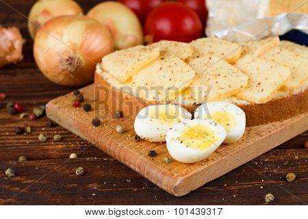 Boiled Quail Eggs In Front Of Bread With Romadur Cheese