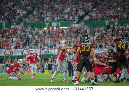 VIENNA, AUSTRIA - JUNE 7, 2014: K Christopher Kappel (#2 Austria) kicks a PAT.