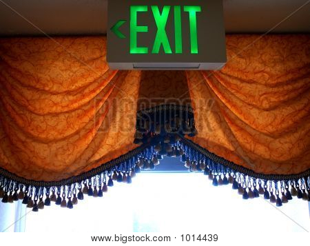 Drapery With Neon Exit Sign
