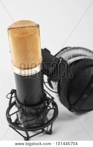 Microphone in a recording studio on a white background
