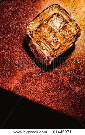 Top Of View Of Glass Of Whiskey On Wood Table Artistic Style, Warm Atmosphere