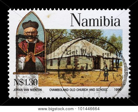 NAMIBIA - CIRCA 1966: a stamp printed in Namibia shows Archbishop Joseph Gotthardt, Ovamboland old church and school, circa 1966.