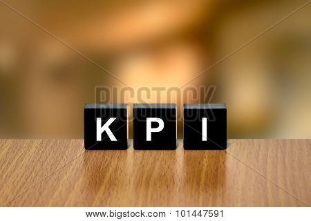 Kpi Or Key Performance Indicator On Black Block