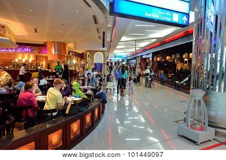 DUBAI - JUNE 23, 2015: airport interior. Dubai International Airport is the primary airport serving Dubai and is the world's busiest airport by international passenger traffic