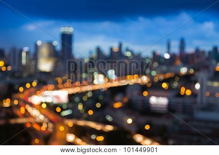 Abstract blurred bokeh city freeway with city background during twilight