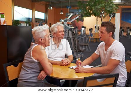 Fitness Trainer Talking To Customers