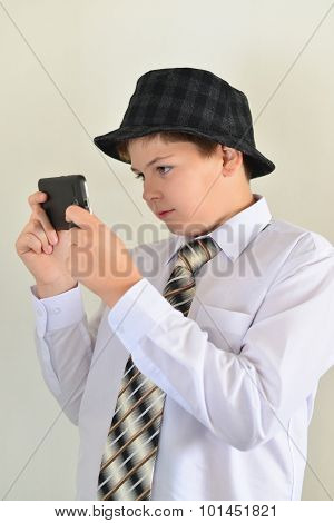 Teen Boy With Surprise Looks At  Mobile Phone