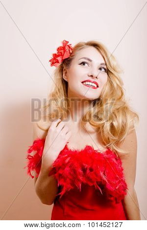 Surprised girl in red dress with flower barrette and boa