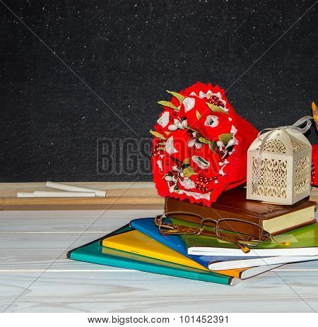 Flowers And Gift , Copybooks On The Teacher's Desk. .