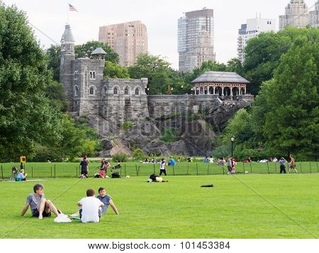 NEW YORK,USA - AUGUST 19,2015 : People enjoying their free time at Central Park with Belvedere Castle on the background