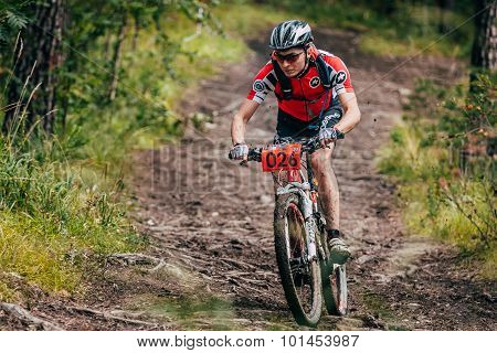 mountainbiker in a downhill mountain