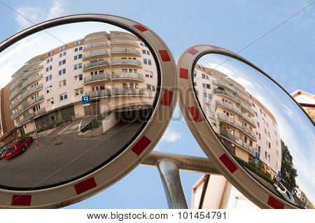 Residential building is reflecting in driveway mirror