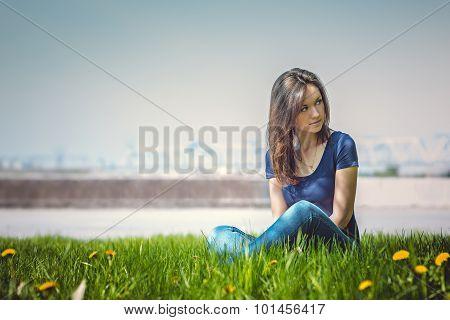 Beautiful Young Woman Relaxing In A Meadow