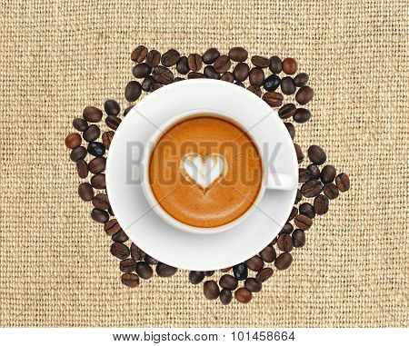 Latte Coffee With Heart Symbol On Linen Texture