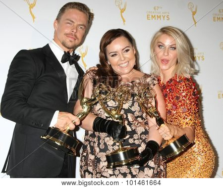 vLOS ANGELES - SEP 12:  Derek Hough, Tessandra Chavez, Julianne Hough at the Primetime Creative Emmy Awards Press Room at the Microsoft Theater on September 12, 2015 in Los Angeles, CA