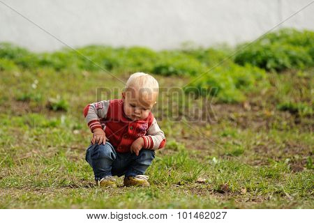 Orel, Russia - September 13, 2015: Orthodox Church Family Day. Single Serious Toddler Sitting In Gra