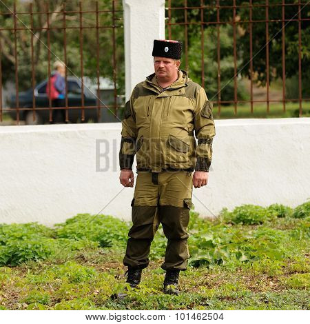 Orel, Russia - September 13, 2015: Orthodox Church Family Day. Russian Cossack In Field Uniform Stan